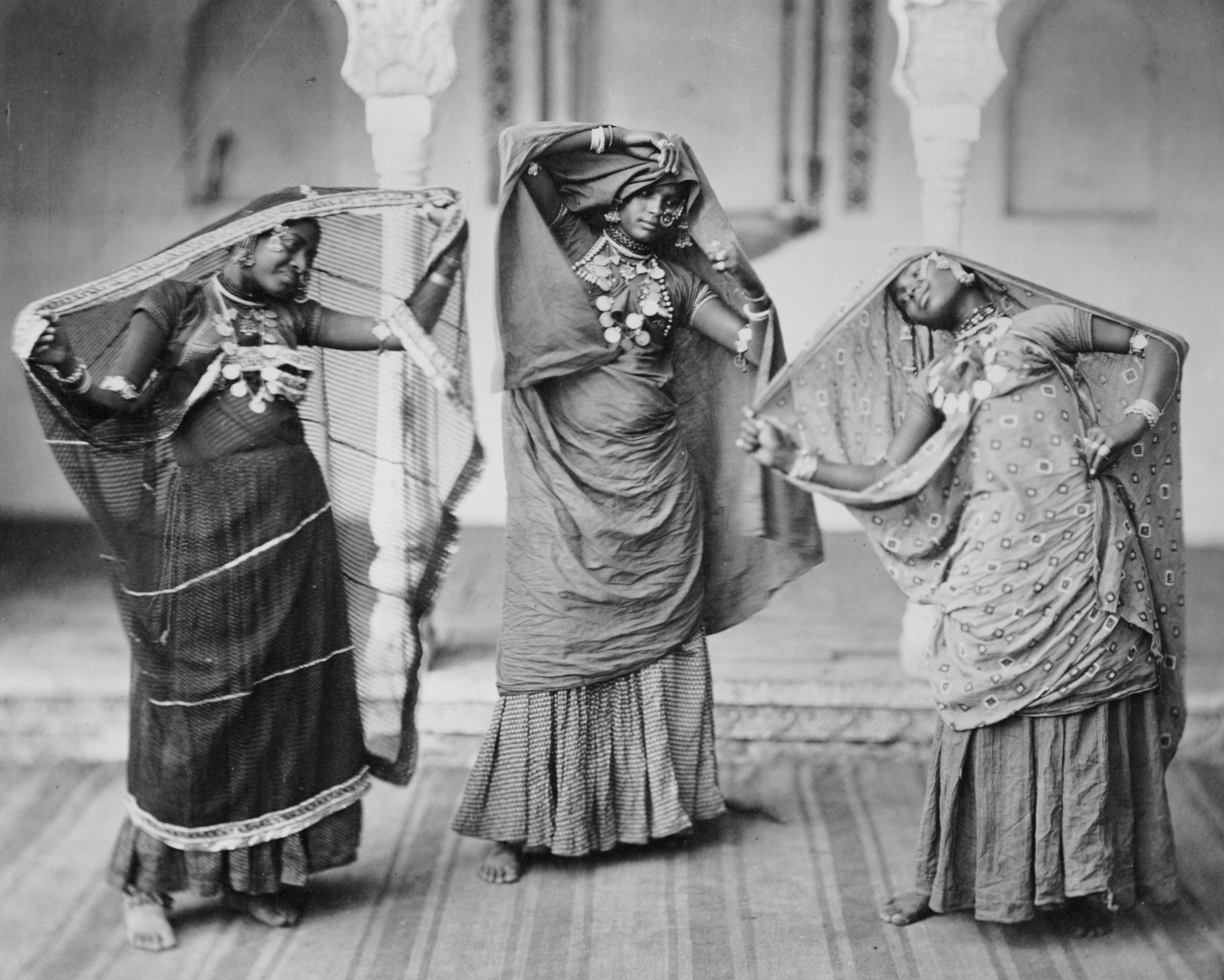 A photograph of three nautch dancers performing together