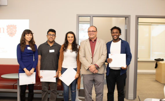 The winners of the 2018-19 Fellowship stand next to Dr. Geoff Read, Dean of Fass, smiling.