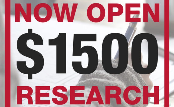 "Over a faded background of a person writing, ""Applications now open: $1500 Research Fellowships"" is written in capital letters."