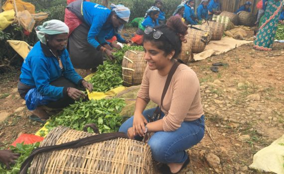 Huron student Valentina Gnanapragasam sits near Sri Lankan plantation workers. Her CURL Travel Bursary helped her volunteer there with Uniterra.
