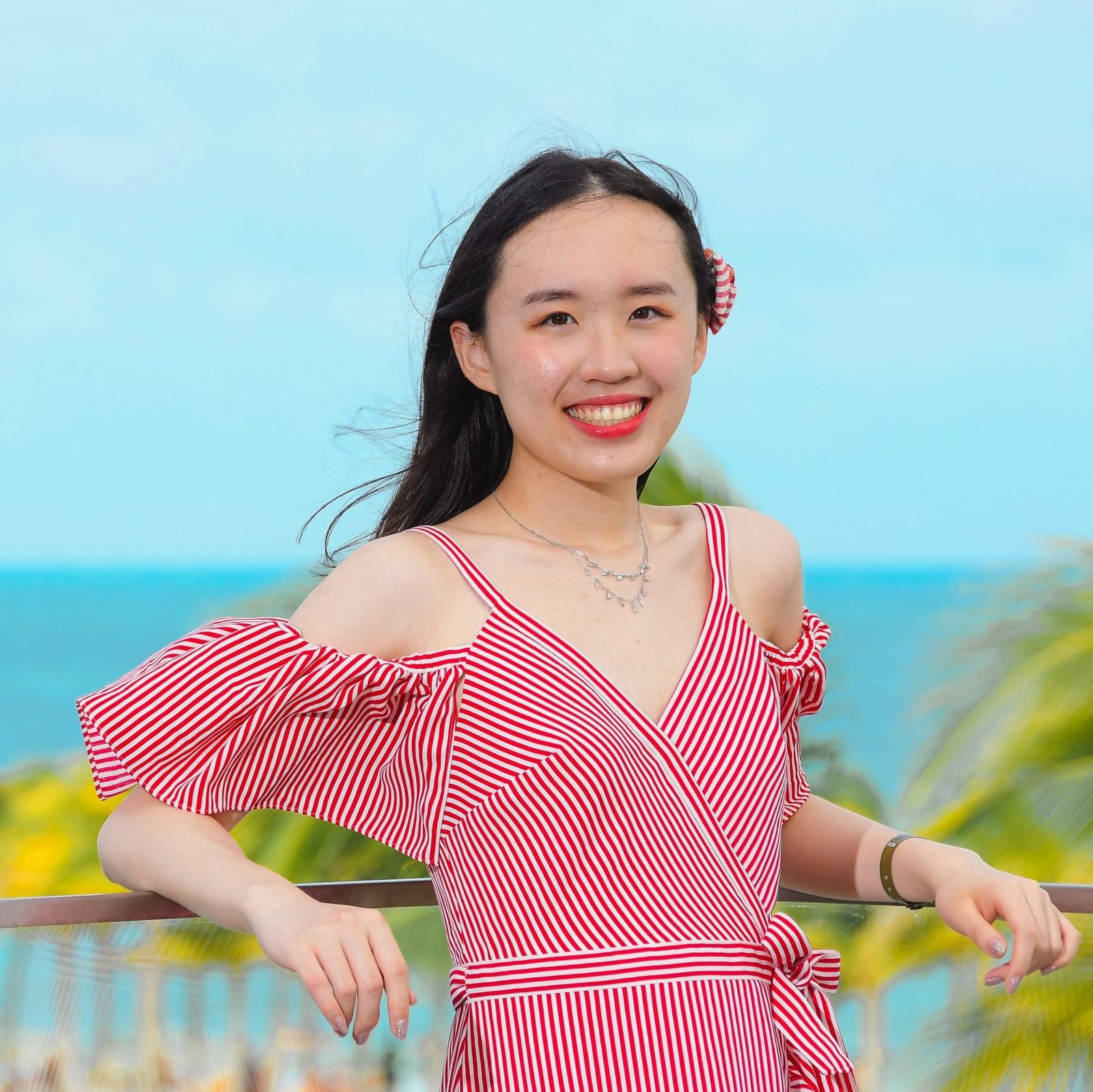 A smiling photo of Ocarina Zheng that links to a page about Babette and Ocarina's project.