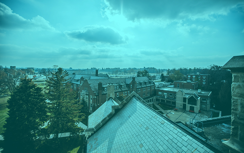 A photograph of the sky as viewed from the roof of the Huron building.
